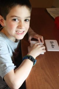 Boy smiling while using robinson curriculum